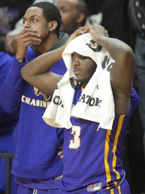 Camden's Isaiah Anfield, left and John Evans, right, watch on late in the 4th quarter of Camden's 51-49 loss to West Side in the boys basketball Group 2 state final played at the Louis Brown Athletic Center at Rutgers University on Sunday.