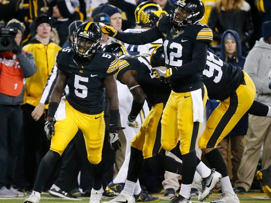 Iowa cornerback Manny Rugamba (5) celebrates with Iowa