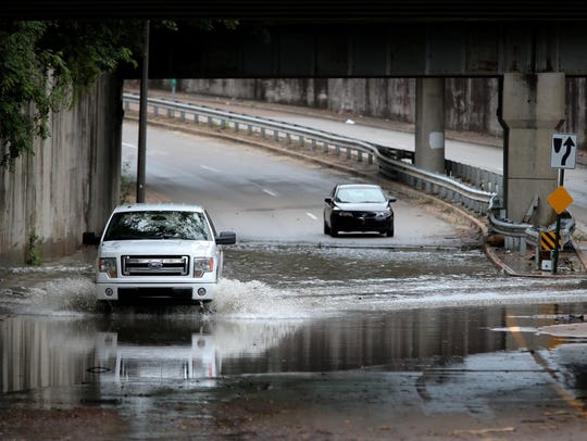 Automobiles brave a flooded stretch of North Parkway