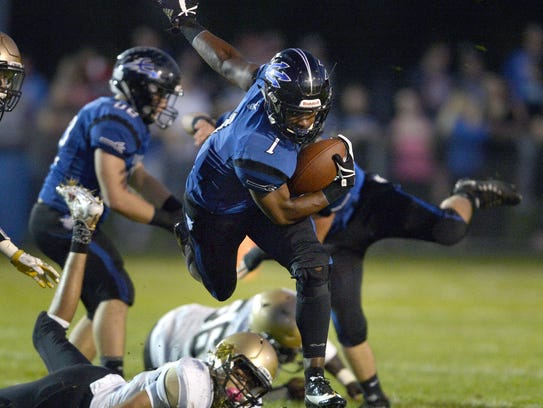 Brockport's Cory Gross breaks a tackle during a regular