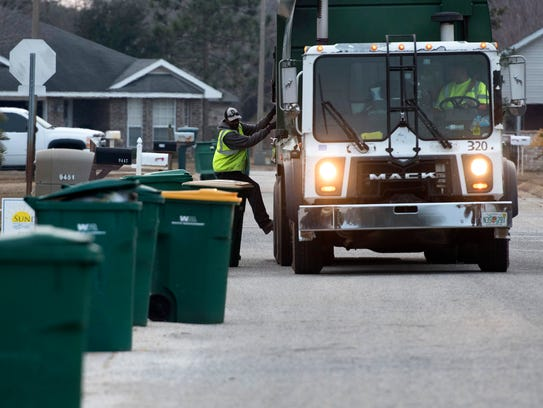 Waste Pro USA crew collects trash off Fox Den Drive