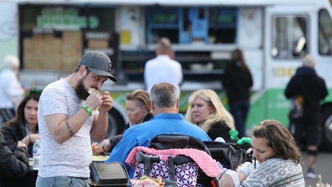 Kyle Myers of Twentynine Palms eats a kabab during the Food Truck Mash Up at the Spa Resort Casino in Palm Springs on Saturday, March 17, 2018.