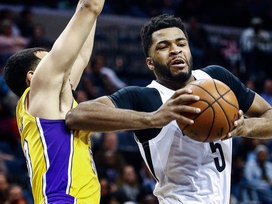 Memphis Grizzlies Andrew Harrison (right) drives the