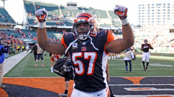Cincinnati Bengals outside linebacker Vincent Rey (57) celebrates with fans following the Cincinnati Bengals win over the Baltimore Ravens  at Paul Brown Stadium in Cincinnati Ohio Sunday October 26, 2014.  The Enquirer/Gary Landers