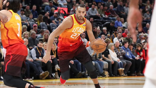Utah Jazz center Rudy Gobert (27) dribbles up the court during the first quarter against the Portland Trail Blazers at Vivint Smart Home Arena.