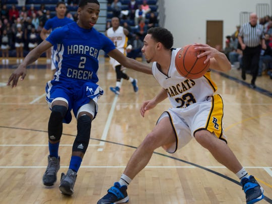 Joseph Bowser, right, a former Battle Creek Central standout, was found dead  Saturday morning.