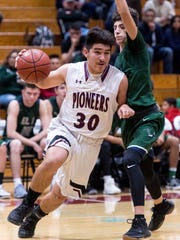 Mt. Whitney's Jaedyn Pineda drives to the basket against