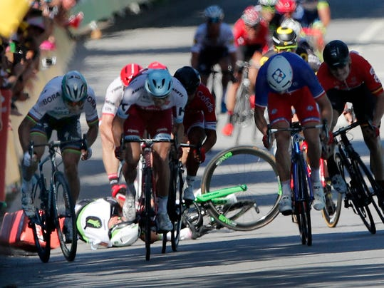 FILE - In this July 4, 2017 file photo, Peter Sagan of Slovakia, left, sprints as Britain's Mark Cavendish crashes, during the sprint of the fourth stage of the Tour de France cycling race in Vittel, France. The UCI ruled Tuesday Dec.5, 2017 that Peter Sagan did not intentionally elbow Mark Cavendish during a sprint finish at the Tour de France in a crash that led to the Slovak rider's disqualification. (AP Photo/Christophe Ena, File)