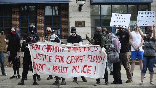Protesters rally in front of the Charlotte-Mecklenburg Police Department-Metro Division station protesting the death of George Floyd in Minneapolis on Friday in Charlotte.