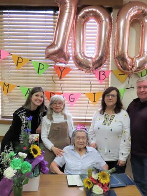 Marjorie Bloom, center, celebrates her 100th birthday with family members, from left, Catie Drussell, Sue Tinsman Briggs, and MaryAnn and Bob Johnson.