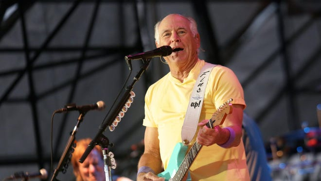 Jimmy Buffett performs for the crowd on June 25, 2015, at West Riverfront Park in Detroit.