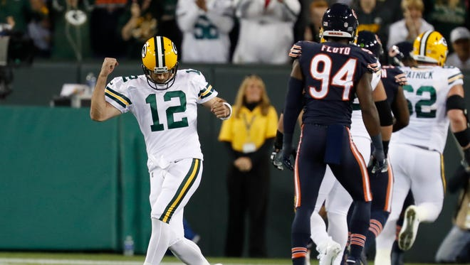 Aaron Rodgers celebrates one of his four touchdown passes in the Packers' 35-14victory over the Bears on Sept. 28 at Lambeau Field.