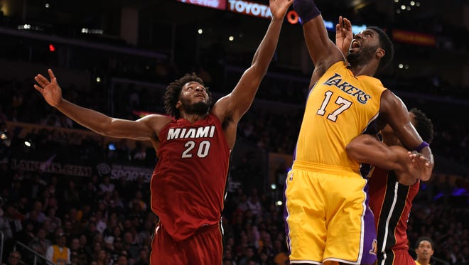 Mar 30, 2016; Los Angeles, CA, USA; Los Angeles Lakers center Roy Hibbert (17) taps in a rebound against Miami Heat forward Justise Winslow (20) during the second half at Staples Center. Mandatory Credit: Richard Mackson-USA TODAY Sports