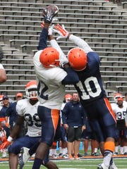 UTEP defensive back Adrian Hynson, 12, gets a hand