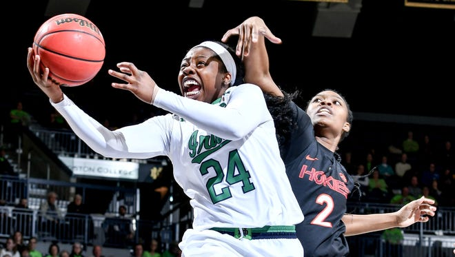 Notre Dame Fighting Irish guard Arike Ogunbowale (24) shoots against Virginia Tech Hokies guard Alisha Sheppard (2) in the second half at the Purcell Pavilion.