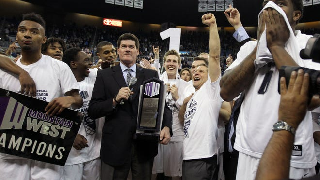 Mountain West commissioner Craig Thompson hands the regular-season tournament trophy to the Wolf Pack last March. Thompson is returning to the NCAA men's basketball selection committee.