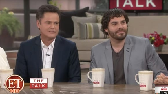 Donny Osmond, left, and Don Osmond Jr. appear on an episode of 'The Talk.'