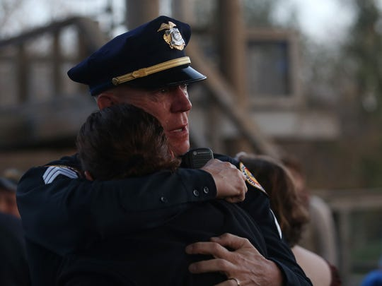 Urbandale Police Sgt. Mark Jorgensen hugs Westcom Dispatch Supervisor Aubyn Giampolo during a candlelight vigil in honor of Officer Justin Martin and Sgt. Anthony Beminio on Friday, Nov. 5, 2016, at Walker Johnston Park in Urbandale. Giampolo and Jorgensen were both working the night the officers were killed.