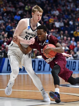 Texas Southern guard Demontrae Jefferson (3) drives to the basket defended by Xavier guard J.P. Macura (55) during the second half of their first round game in the 2018 NCAA Division I Men's Basketball Championship at Bridgestone Arena Friday, March 16, 2018 in Nashville, Tenn.