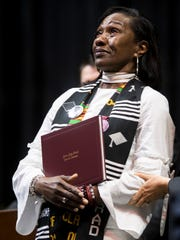 Zenobia Dobson looks up toward the sky after receiving her son Zaevion Dobson's degree at Fulton High's graduation at Thompson-Boling Arena on Thursday, May 17, 2018.