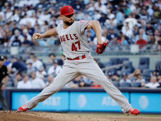 Los Angeles Angels' Ricky Nolasco winds up during the first inning of the team's baseball game against the New York Yankees on Wednesday, June 21, 2017, in New York. (AP Photo/Frank Franklin II)