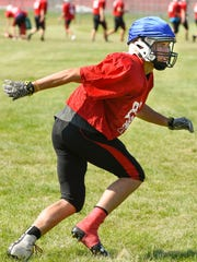 Pierz safely watches the play develop during practice Wednesday, Aug. 23, in Pierz.