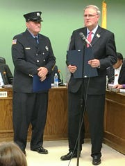 """Ringwood's Richard """"Pep"""" Peplowski Sr. was recognized for 50 years as a volunteer with the Skyline Lake Fire Department during the Oct. 18 Borough Council meeting. Assemblyman Robert Auth read from a proclamation honoring Peplowski for his service to the community."""