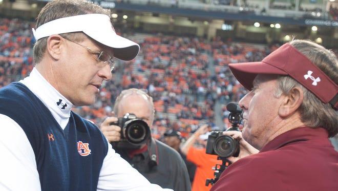 Auburn coach Gus Malzahn greets South Carolina coach Steve Spurrier before the game between Auburn and South Carolina on Saturday night.