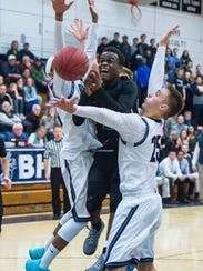 Rice Memorial's Michel Ndayishimiye, center, loses