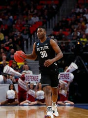 Mar 16, 2018; Detroit, MI, USA; Butler Bulldogs forward Kelan Martin (30) moves down the court in the second half in the first round of the 2018 NCAA Tournament at Little Caesars Arena. Mandatory Credit: Rick Osentoski-USA TODAY Sports