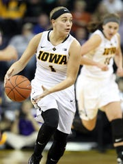 Iowa's Alexa Kastanek takes the ball down court during the Hawkeyes' game against Western Illinois at Carver-Hawkeye Arena on Thursday, Nov. 19, 2015.