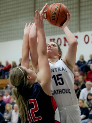 Central Catholic's Libby Bonner shoots a jumper over Madison Cooksey of Seeger in the fourth quarter.