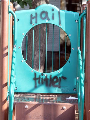 Graffiti is shown on playground equipment behind 131 Second Street in Lakewood Friday morning, August 26, 2016.