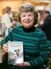 Historical fiction author Leonide Martin with her book