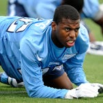 Former Naval Academy safety Parrish Gaines stretches before a Titans practice on Friday at Saint Thomas Sports Park. Gaines is trying out for the Titans.