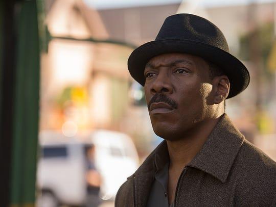 """Eddie Murphy stars in """"Mr. Church."""" The movie opens"""