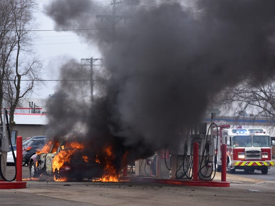 A car is totally engulfed in flames as St. Cloud firefighters