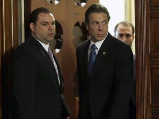 Joseph Percoco, left, enters the state Capitol's Red