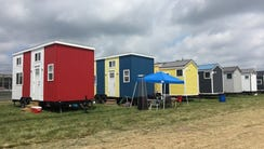A row of tiny houses sit on expansive property at Indianapolis