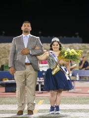 Samantha Gonzalez, a AIM Program student, was elected the 2017 Coronado homecoming queen by her classmates. Gonzalez and her father wait to be introduced to the student body and fans that attended Friday night's homecoming game between Coronado and Pebble Hills.