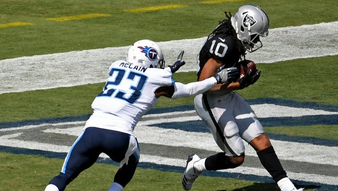 Raiders wide receiver Seth Roberts (10) catches a touchdown pass against Titans cornerback Brice McCain (23) in the second half Sunday, Sept. 10, 2017, at Nissan Stadium.
