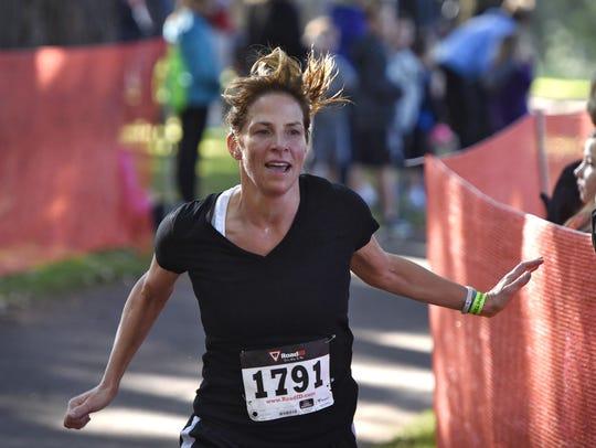 Chris Haukos crosses the finish line during Saturday's
