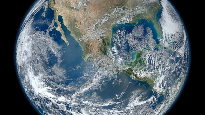 Some of Earth's land and vast oceans are depicted in this satellite photo taken from the VIIRS instrument aboard NASA's most recently launched Earth-observing satellite, Suomi NPP.