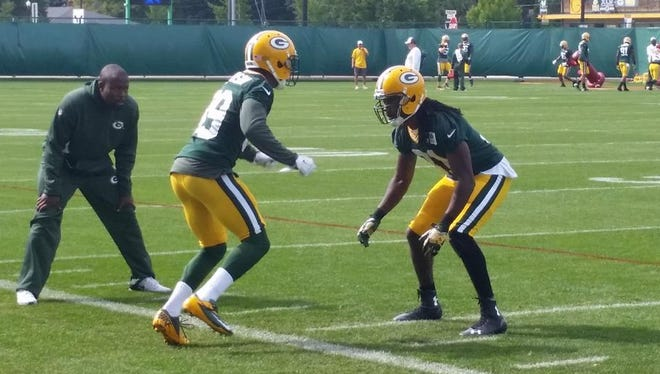 Green Bay Packers cornerback Davon House, right, practiced Wednesday with a leg sleeve with a pad over his left kneecap.