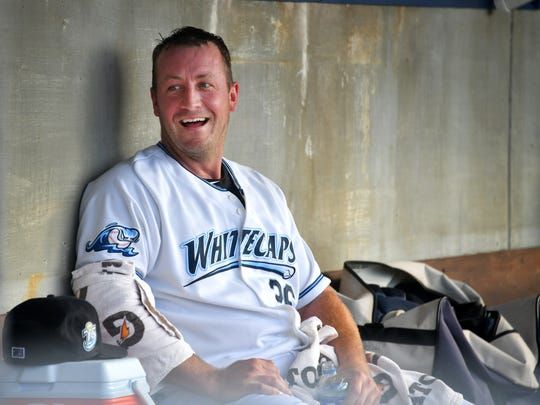 Jordan Zimmermann jokes with teammates in the dugout