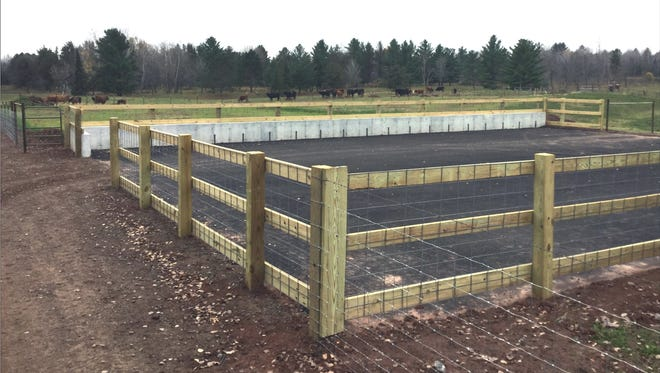 An asphalt barn lot on the farm of Larry Ekholm is one of the first of its kind in Bayfield County.