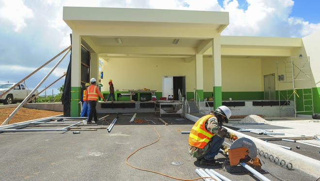 Contractors continue work on completing the Guam Farmers Co-Op facility in Dededo on Thursday, Oct. 8.
