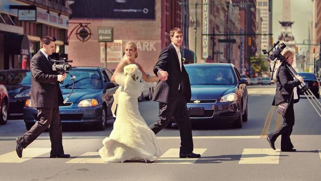 Videographers Brandon and Cybil New are on the job following a newly married couple through Downtown Indianapolis.