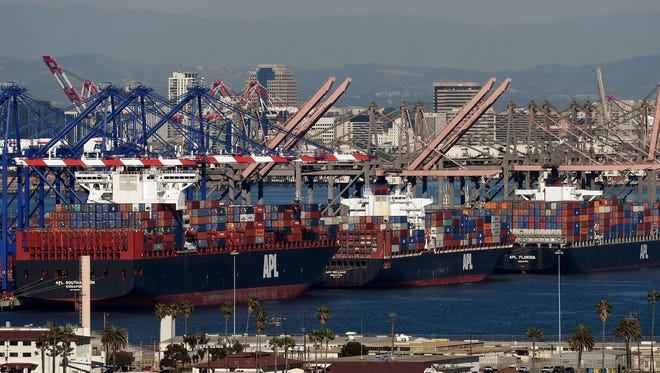 Ships wait to be unloaded at the Port of Los Angeles in Long Beach, Calif., in February.