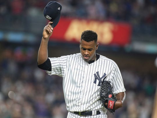New York Yankees pitcher Luis Severino (40) acknowledges